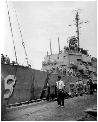 Bow being separated from main part of destroyer.